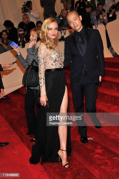 """Actress Diane Kruger and designer Jason Wu attend the """"Alexander McQueen: Savage Beauty"""" Costume Institute Gala at The Metropolitan Museum of Art on..."""
