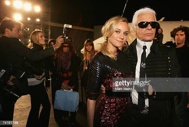 Actress Diane Kruger and Designer Karl Lagerfeld attend the 2007/8 Chanel Cruise Show Presented By Karl Lagerfeld held at Hangar 8 on May 18, 2007 in...
