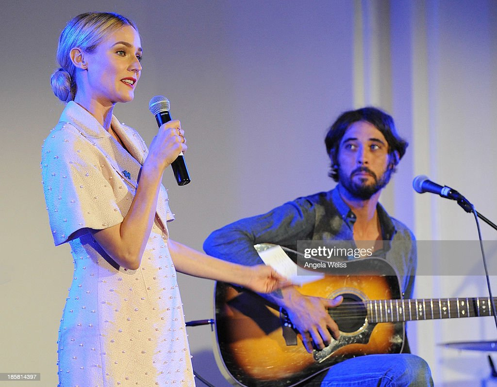 Actress Diane Kruger and musician Ryan Bingham on stage at Autism Speaks' 3rd Annual 'Blue Jean Ball' presented by The GUESS Foundation at Boulevard 3 on October 24, 2013 in Hollywood, California.