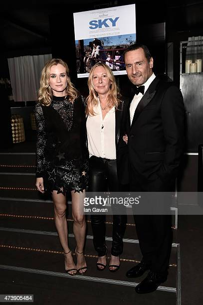 Actress Diane Kruger director Fabienne Berthaud and actor Gilles Lellouche attend a rooftop reception for the upcoming movie SKY during the 68th...
