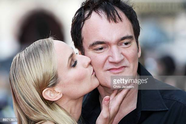 Actress Diane Kruger kisses Director Quentin Tarantino prior to the UK film premiere of Inglourious Basterds at the Odeon Leicester Square on July 23...