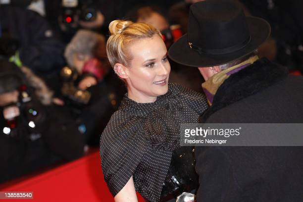 Actress Diane Kruger talks to festival director Dieter Kosslick as she attends the 'Les Adieux De La Reine' Premiere during day one of the 62nd...