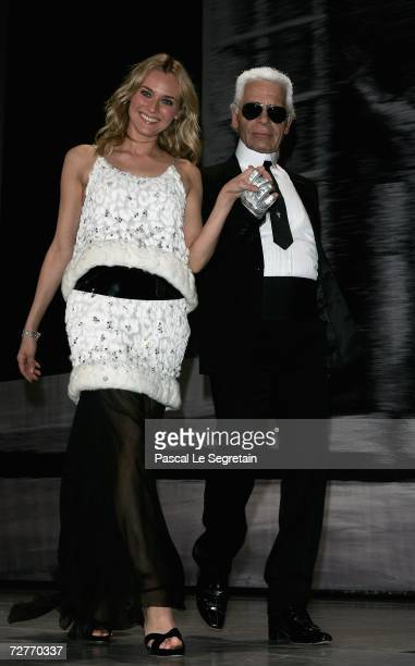 Actress Diane Kruger walks on stage with designer Karl Lagerfeld during the 4th biennial Nijinsky Awards hosted by Princess Caroline of Hanover and...