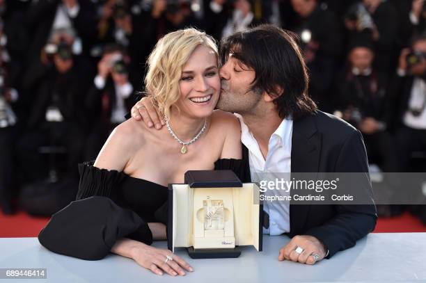 Actress Diane Kruger who won the award for best actress for her part in the movie 'In The Fade' and director Fatih Akin attend the Palme D'Or Winner...