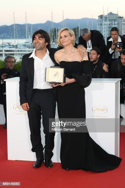 Actress Diane Kruger who won the award for best actress for her part in the movie In The Fade and director Fatih Akin attend the Palme D'Or Winner...