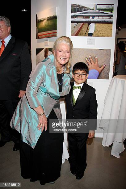 Actress Diane Ladd poses with one of the children of Hollygrove at the 1st Annual Norma Jean Gala held at the TCL Chinese Theatre on March 20 2013 in...