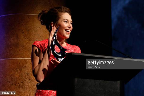 Actress Diane Lane accepts the 'Award for Cinematic Excellence' at the closing night ceremony and screening of 'Paris Can Wait' during the 2017...