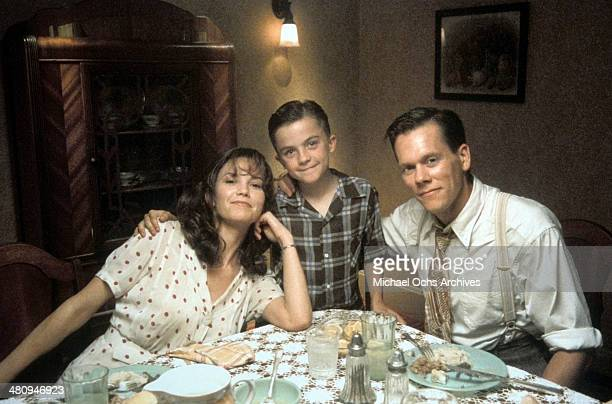 Actress Diane Lane actor Frankie Muniz and actor Kevin Bacon pose in a scene from the Warner Brothers movie My Dog Skip circa 2000