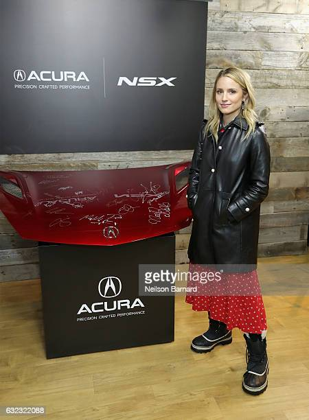 Actress Dianna Agron of 'Novitiate'' signs the hood of a 2017 Acura NSX at the Acura Studio during Sundance Film Festival 2017 on January 21 2017 in...