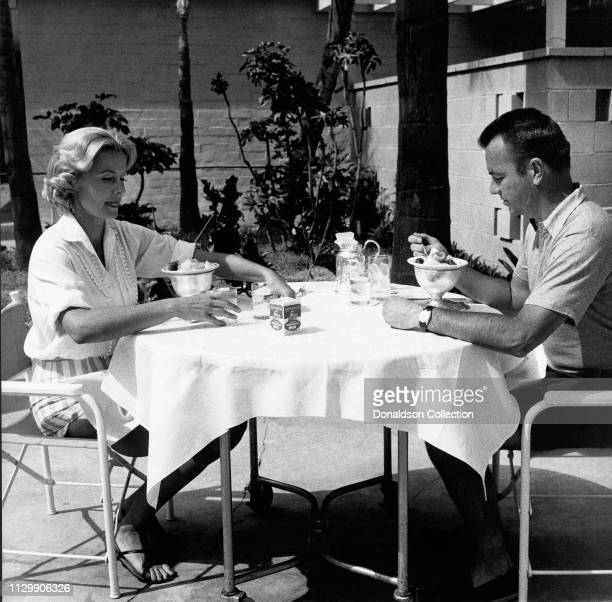 Actress Dina Merrill lunches with her husband Stanley M. Rumbough Jr. At the Hotel Bel Air in 1958.