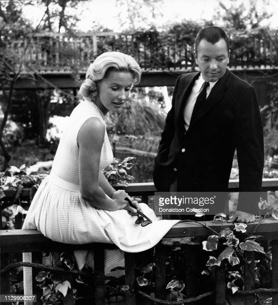 Actress Dina Merrillwith her husband Stanley M Rumbough Jr at the Hotel Bel Air in 1958