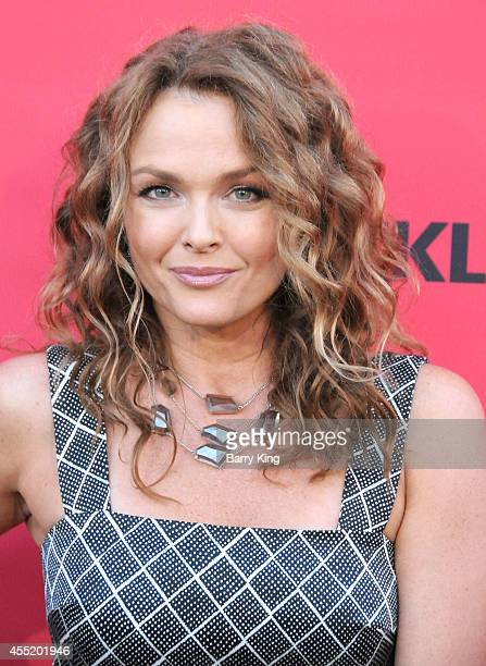 Actress Dina Meyer arrives at the Crackle Original Series' 'Cleaners' and 'Sequestered' Summer premiere celebration at 1 OAK on August 14 2014 in...