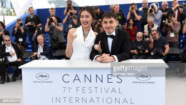 Actress Dinara Baktybaeva and director Adilkhan Yerzhanov attends 'The Gentle Indifference Of The Word' Photocall during the 71st annual Cannes Film...