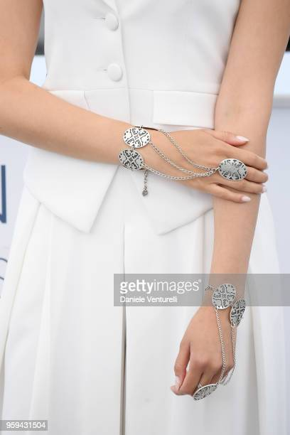 Actress Dinara Baktybaeva jewellery detail attends the photocall for the 'The Gentle Indifference Of The Word' during the 71st annual Cannes Film...