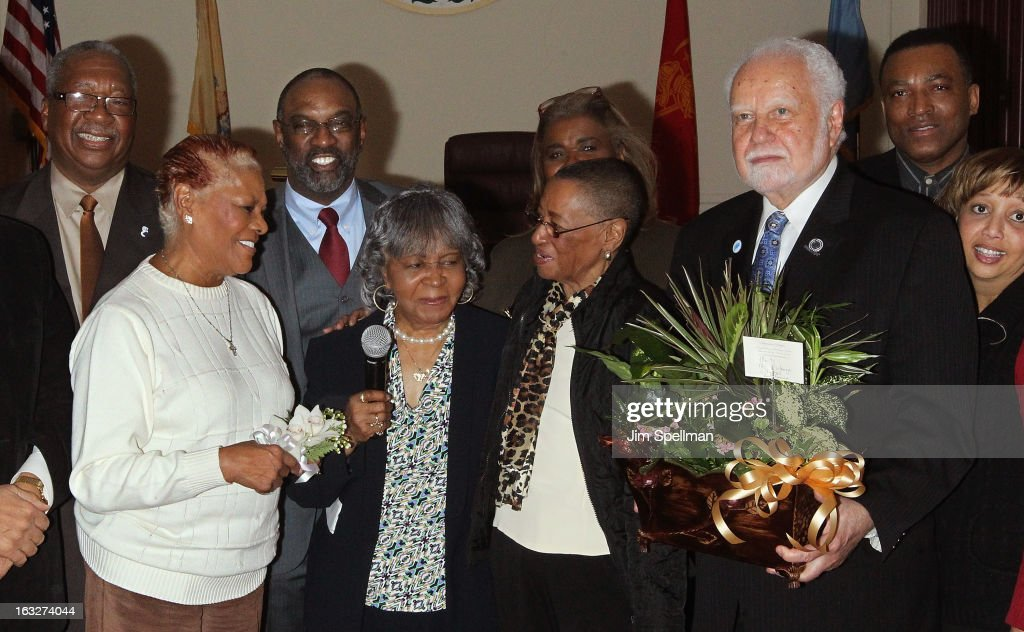 Actress Dionne Warwick, Rev. Dr. Leonard Santucci (back row), co-chair, 150th anniversary celebration committee Goldie T. Burbage and Mayor of the City of East Orange NJ Robert L. Bowser (R) attend the 150th Anniversary of East Orange, New Jersey at Council Chambers on March 6, 2013 in East Orange, New Jersey.