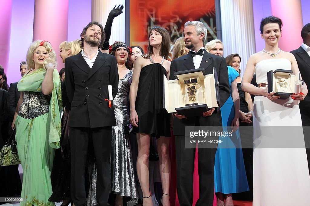 actress Dirty Martini and French director and actor Mathieu Amalric, French actress Charlotte Gainsbourg, Autralian director Michael Rowe and French actress Juliette Binoche pose with their awards during the closing ceremony at the 63rd Cannes Film Festival on May 23, 2010 in Cannes.