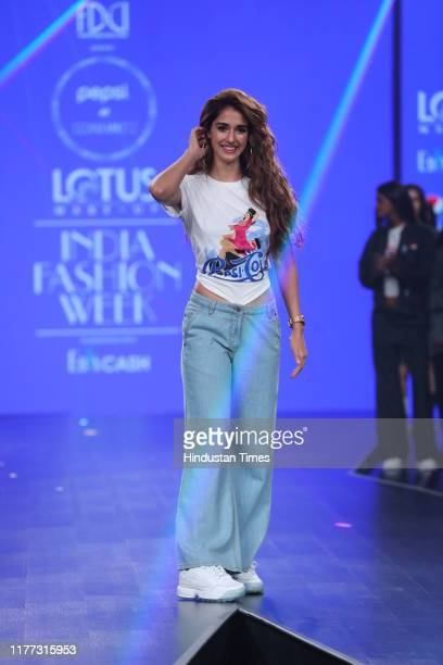 Actress Disha Patani walks the ramp for Pepsi X Huemn on the first day of the FDCI's Lotus Makeup India Fashion Week at Major Dhyan Chand National...