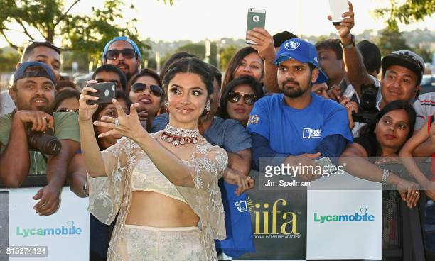 Actress Divya Khosla Kumar poses with the fans at the 2017 International Indian Film Academy Festival at MetLife Stadium on July 14 2017 in East...