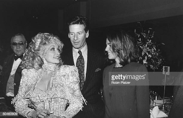 Actress Dolly Parton with fashion designer Calvin Klein and wife Kelly at the premiere of the motion picture Steel Magnolias
