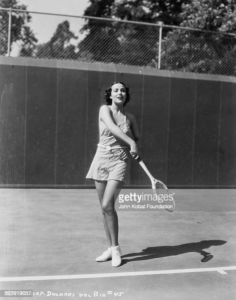 Actress Dolores del Rio pictured playing tennis on an outdoor court for Columbia Pictures 1937