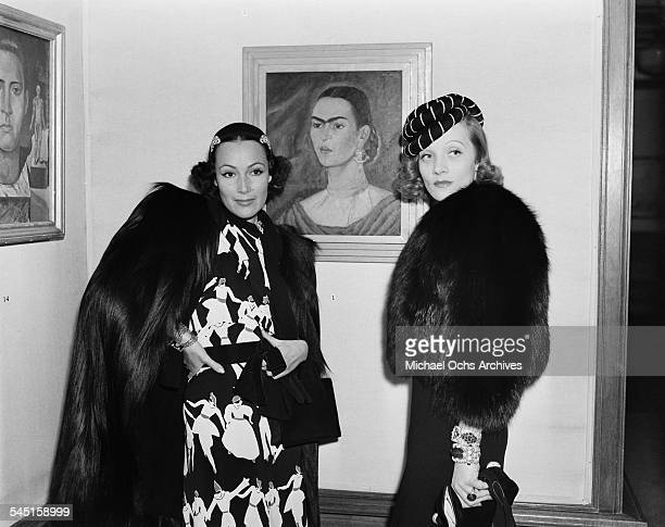 Actress Dolores del Rio poses with actress Marlene Dietrich at a gallery featuring the paintings of Mexican artist Frida Kahlo in Los Angeles...