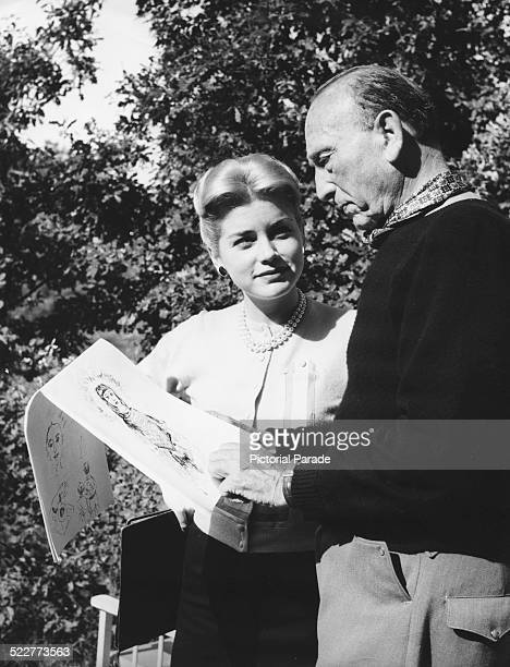 Actress Dolores Hart and director Michael Curtiz looking at her sketches on the set of the film 'Francis of Assisi' 1961