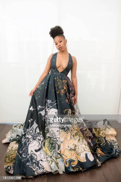 "Actress Dominique Fishback nominated for best actress in a supporting role for ""Judas and the Black Messiah"" poses in her award show look for the EE..."