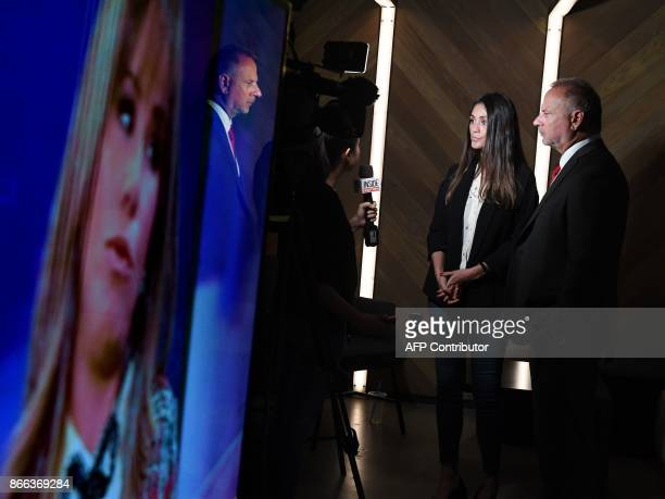 Actress Dominique Huett and her attorney Jeff Herman answer journalists' questions after they held a news conference to discuss her lawsuit against...