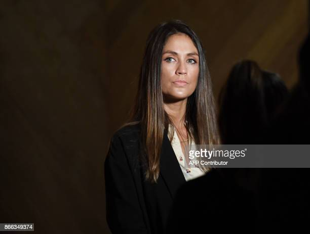 Actress Dominique Huett listens to her attorney Jeff Herman speak during a news conference to discuss her lawsuit against The Weinstein Company in...