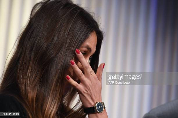 Actress Dominique Huett reacts as she listens to her attorney Jeff Herman speak during a news conference to discuss her lawsuit against The Weinstein...
