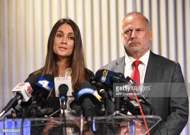 Actress Dominique Huett speaks beside her attorney Jeff Herman after a news conference to discuss her lawsuit against The Weinstein Company in Los...