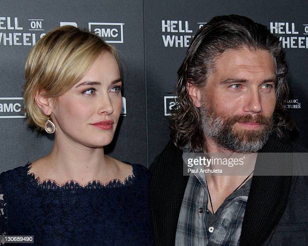 Actress Dominique McElligott and Actor Anson Mount attend AMC's new series Hell On Wheels premiere party at LA LIVE on October 27 2011 in Los Angeles...