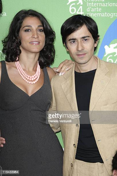 Actress Donatella Finocchiaro and Luigi Lo Cascio attends the Il Dolce E L'Amaro Photocall in Venice during day 7 of the 64th Venice Film Festival on...
