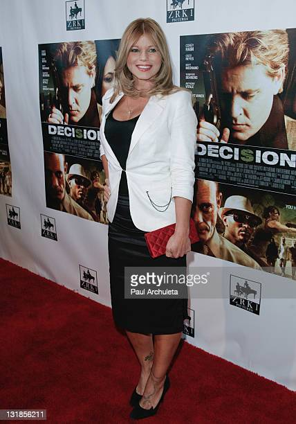 Actress Donna D'Errico arrives at the Decisions premiere and celebration of the life of actor Corey Haim at Writers Guild Theater on April 10 2011 in...