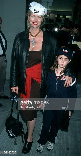 Actress Donna Dixon and daughters Danielle Aykroyd Belle Aykroyd and Stella Aykroyd attend the grand opening of Roots Department Store in New York...