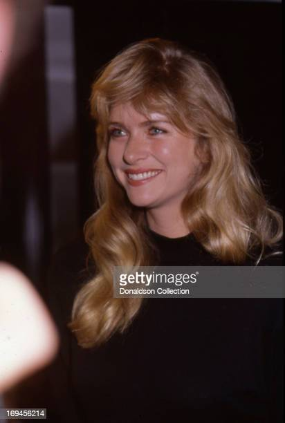 Actress Donna Dixon holds up a drink at the book release party for Renee Taylor's book 'My Life On A Diet Confessions of a Hollywood Diet Junkie' in...