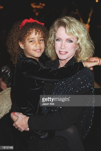 Actress Donna Mills and adopted daughter Chloe pose for a picture during Merv Griffins 7th Annual Christmas Tree Lane Lighting Ceremony and Live...