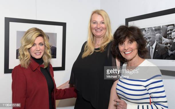 Actress Donna Mills photographer Anna Wilding and actress Adrienne Barbeau attend the opening of her new exhibition Celebrate Hope The Obama White...