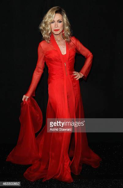 Actress Donna Mills prepares backstage at the Go Red For Women Red Dress Collection 2015 presented by Macy's fashion show during MercedesBenz Fashion...
