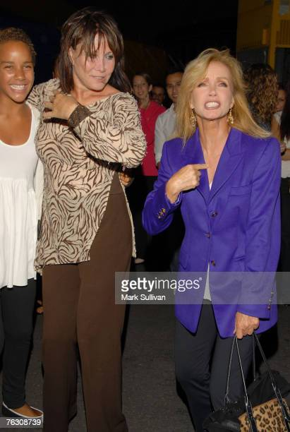 Actress Donna Mills right and daughter Chloe with actress Michele Lee center arrive at opening night of Cirque du Soleil Corteo held in Inglewood...