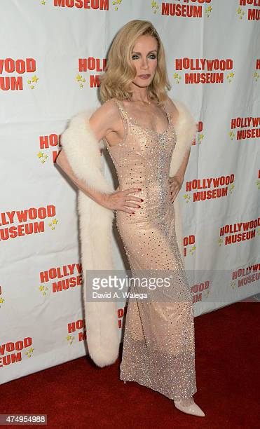 Actress Donna Mills wears a dress worn by actress Marilyn Monroe at the opening night reception for 'Marilyn Monroe Missing Moments' at The Hollywood...