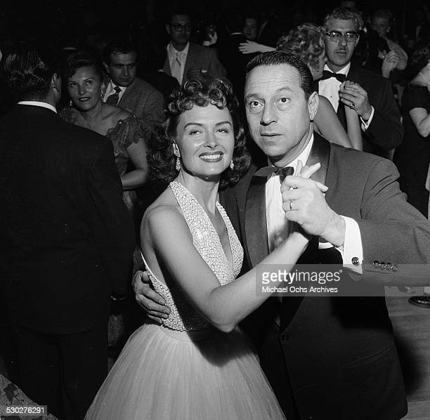 Actress Donna Reed and her husband Film Producer Tony Owen dance at the opening night for Tony Martin at the Cocoanut Grove in Los Angeles,CA.