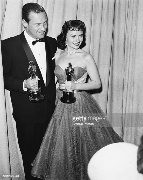 Actress Donna Reed holding her Oscar for the film 'From Here to Eternity', with actor William Holden holding his Oscar for the film 'Stalag 17', at...