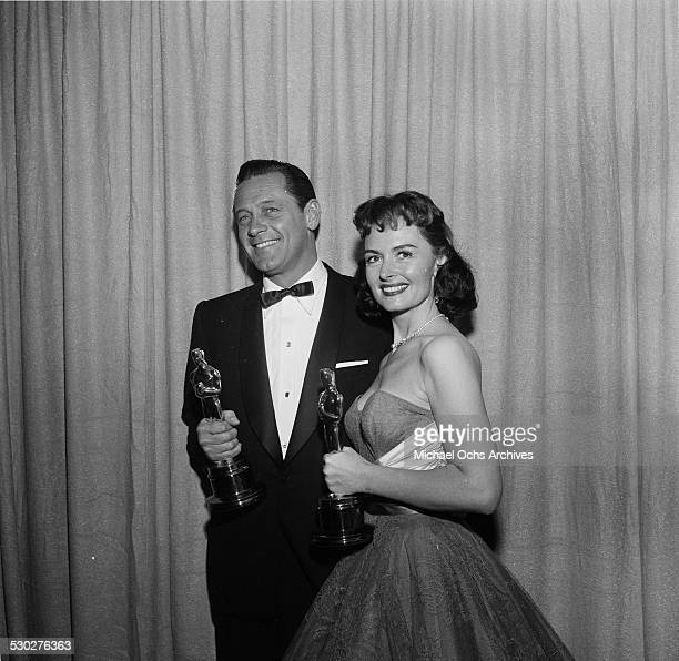 "Actress Donna Reed poses with her Academy Award for Best Supporting Actress in ""From here to Eternity"" and William Holden for Best Actor for ""Stalag..."