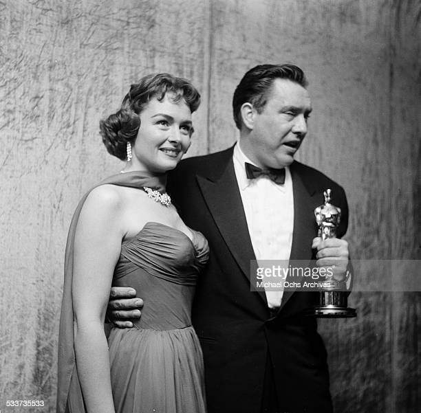 Actress Donna Reed with actor Edmond O'Brien and his Oscar forThe Barefoot Contessa during the Academy Awards in Los AngelesCA