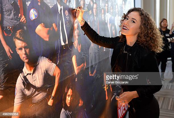 Actress Dora Madison signs a poster as she attends a press junket for NBC's 'Chicago Fire' 'Chicago PD' and 'Chicago Med' at Cinespace Chicago Film...