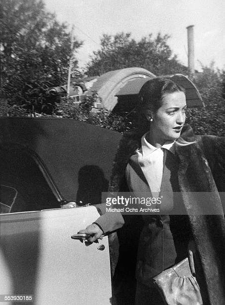 Actress Dorothy Lamour poses as she enters her car on a street in Los Angeles California