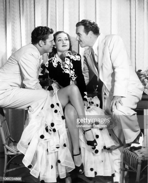 Actress Dorothy Lamour Robert Preston and Preston Foster in a scene from the movie Moon Over Burma