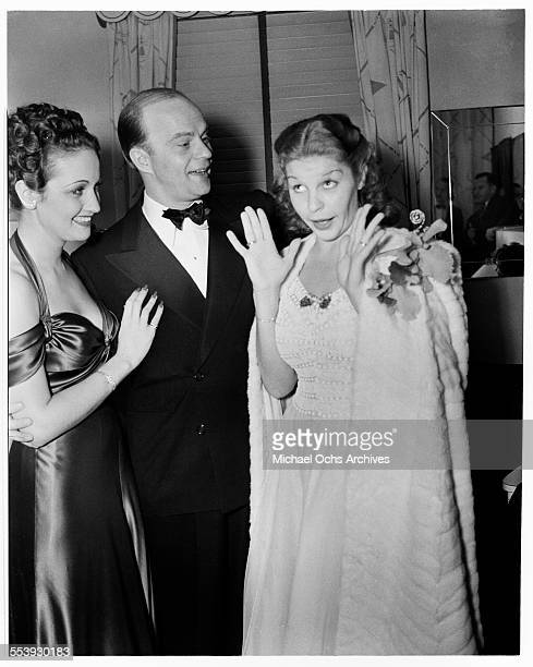 Actress Dorothy Lamour with actor Edgar Bergen laugh at actress Martha Raye during an event in Los Angeles California