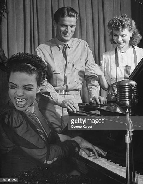 https://media.gettyimages.com/photos/actress-dorothy-mcguire-and-singer-hazel-scott-playing-host-to-men-picture-id50481260?s=612x612